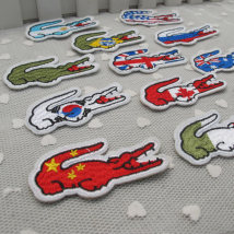 Cloth stickers 1, 2, 3, 4, 5, 6, 7, 8, 9, 10, 11, 12, one for each Leimia Crocodile gum paste