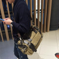 Men's bag The single shoulder bag canvas Canvas Khaki (stock) Canvas Black (stock) brand new leisure time Japan and South Korea zipper hard large no Zipper pocket, mobile phone bag, certificate bag Solid color nothing Single root youth Horizontal square Color contrast Soft handle