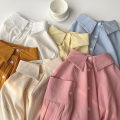 shirt Apricot, yellow, white, blue, pink, orange Average size Summer 2021 cotton 51% (inclusive) - 70% (inclusive) Long sleeves commute Regular Polo collar Single row multi button shirt sleeve other 18-24 years old Straight cylinder Korean version Button polyester cotton