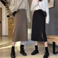 skirt Spring 2021 S,M,L Black front split, coffee front split, black back split, coffee back split Mid length dress commute High waist Irregular Solid color Type H 18-24 years old 30% and below other Korean version