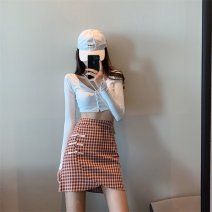 skirt Summer 2020 S,M,L Red, black Short skirt Versatile High waist Irregular lattice Type A 18-24 years old 71% (inclusive) - 80% (inclusive) brocade polyester fiber