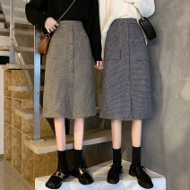 skirt Winter 2020 S M L XL Khaki black and white Mid length dress Versatile High waist A-line skirt lattice Type A 18-24 years old one thousand one hundred and nine - 00011 91% (inclusive) - 95% (inclusive) Carrie & jolly / Carly jolly polyester fiber Pocket button zipper Other polyester 95% 5%
