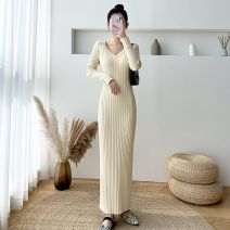 Dress Winter 2020 Black, apricot, khaki, blue, pink, tan S,M,L longuette singleton  Long sleeves commute V-neck Elastic waist Solid color Socket One pace skirt routine Others 25-29 years old Type H Other Korean version 30% and below knitting acrylic fibres