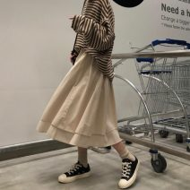 skirt Spring 2021 Average size Black, khaki Mid length dress commute High waist Irregular Solid color Type A 18-24 years old 31% (inclusive) - 50% (inclusive) other other Korean version
