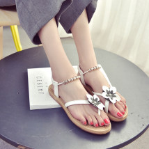 Sandals 36 37 38 39 40 White black Other / other PU Pinch toe Flat bottom Flat heel (1cm or less) Summer 2017 Trochanter Korean version Solid color Adhesive shoes Youth (18-40 years old) rubber daily Rear trip strap Floral Beaded Roman style Low Gang Hollow PU PU Roman shoes Patent leather One