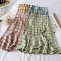 skirt Winter of 2019 Average size Pink, green, yellow, blue, black Short skirt Versatile High waist Irregular lattice 18-24 years old A26504 30% and below