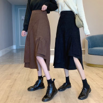 skirt Winter 2020 Average size Black, brown Mid length dress Versatile High waist A-line skirt Solid color Type A 18-24 years old other other Asymmetry