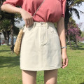 skirt Summer of 2019 S,M,L,XL Black, beige Short skirt Versatile High waist A-line skirt Solid color Type A 18-24 years old 91% (inclusive) - 95% (inclusive) Denim cotton