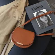 Bag The single shoulder bag PU Small round bun Other / other Brown, pink, black brand new Retro Small leisure time hard Magnetic buckle no Solid color Single root One shoulder cross nothing youth Saddle shape Sewing Telescopic handle Jam Artificial leather