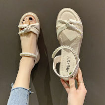 Sandals PU Other / other Barefoot Flat heel (1cm or less) Flat bottom Summer 2021 Korean version Trochanter Solid color Adhesive shoes Youth (18-40 years old) rubber daily Ankle strap Beads, Roman style Hollow PU PU 2021042913 Roman shoes Shaving Green, beige 35,36,37,38,39,40