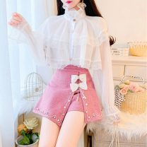 skirt Spring 2021 S,M,L,XL White shirt + black shorts, apricot shirt + off white shorts, white shirt + pink shorts, apricot shirt + pink shorts, white shirt, apricot shirt, black shorts skirt, off white shorts skirt, pink shorts skirt Short skirt Sweet High waist Irregular Solid color Type A college