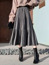 skirt Spring 2020 One size eight to two size three Black, coffee, army green, grey longuette commute High waist Pleated skirt Solid color Type A 18-24 years old KM1117 Other / other Fold, splice Korean version
