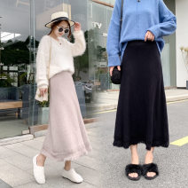 skirt Winter 2020 S,M,L,XL,2XL Black, brown, flowered apricot, white apricot longuette commute High waist A-line skirt Solid color Type A other other Fringes, ruffles, asymmetry Korean version