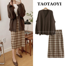 sweater Autumn 2020 S. M, l, XL, one size fits all Brown sweater, plaid skirt Long sleeves Cardigan Two piece set Regular acrylic fibres 31% (inclusive) - 50% (inclusive) Regular commute puff sleeve Solid color Straight cylinder Fine wool Keep warm and warm 18-24 years old Thread, button