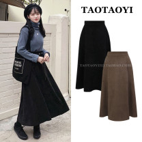 skirt Winter 2020 S,M,L,XL Black, brown Mid length dress Versatile High waist A-line skirt Solid color Type A 18-24 years old 51% (inclusive) - 70% (inclusive) brocade Pleated, zipper