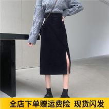 skirt Winter 2020 M,L,XL,2XL,3XL,4XL black Mid length dress Versatile High waist A-line skirt Solid color Type A 18-24 years old corduroy polyester fiber Asymmetric, zipper