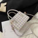 Bag The single shoulder bag PU Small square bag Other / other brand new Japan and South Korea Small leisure time hard zipper no Geometric pattern Single root One shoulder cross carry nothing youth Horizontal square lattice Soft handle soft surface Three dimensional bag