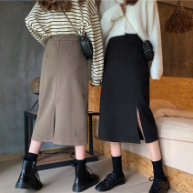 skirt Spring 2021 XXS,XS,S,M Black front split (pre-sale for a week), coffee front split (pre-sale for a week or so), black back split (pre-sale for a week or so), coffee back split (pre-sale for a week or so) Mid length dress Versatile High waist A-line skirt Solid color Type A 18-24 years old other