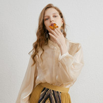shirt Beige shirt white shirt Beige embroidered T-shirt 155/80A/XS 160/84A/S 165/88A/M 170/92A/L Autumn of 2019 polyester fiber 96% and above Long sleeves commute Medium length Lotus leaf collar Single row multi button bishop sleeve Solid color 25-29 years old Cocoon / coconi Simplicity fold