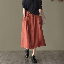 skirt Autumn 2020 L [below 125 kg], XL [125-140 kg], 2XL [140-155 kg] Black, green, apricot, caramel Mid length dress Versatile Natural waist A-line skirt Solid color Type A DT0901 Pocket, button