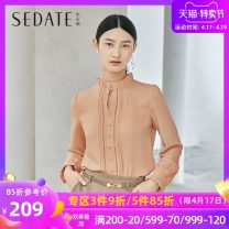 shirt orange red S M L XL XXL Spring 2021 polyester fiber 96% and above Long sleeves commute Regular stand collar Single row multi button routine Solid color 25-29 years old Straight cylinder Sedate Korean version Button Polyester 100% Same model in shopping mall (sold online and offline)