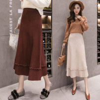 skirt Winter of 2018 One size fits 130 kg Black, apricot, brown Short skirt Sweet other Solid color 25-29 years old 81% (inclusive) - 90% (inclusive) knitting Other / other acrylic fibres Stitching, ruffles