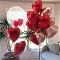 Floating balloon There are 10 18 inch red love aluminum film balloons, 10 18 inch rose gold love aluminum film balloons, 10 18 inch rose gold red love aluminum film balloons, 1 24 inch wave ball + 10 5 inch ruby red balloons