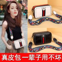 Bag The single shoulder bag cowhide Small square bag Other / other brand new European and American fashion Small leisure time soft zipper no Solid color Single root One shoulder cross Yes youth Horizontal square Sewing Soft handle polyester fiber Inner patch pocket
