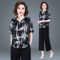 Middle aged and old women's wear Spring 2021 Black and white XL 2XL 3XL 4XL fashion suit easy Two piece set stripe Socket moderate V-neck routine routine W-XYTY263 Kelly nag polyester Other polyester 95% 5% 91% (inclusive) - 95% (inclusive) Pure e-commerce (online only) Ninth pants