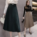 skirt Winter of 2019 S,M,L,XL Khaki, dark green, black Mid length dress commute High waist Pleated skirt Solid color Type A 18-24 years old 51% (inclusive) - 70% (inclusive) Other / other cotton Button, zipper Korean version