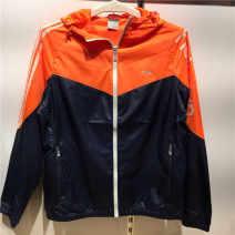 Sports windbreaker female A463042 Guirenniao S,L,XL,2XL,3XL,4XL,M Autumn 2015 Detachable cap zipper Brand logo nylon Sports life Waterproof, breathable, wear resistant