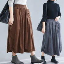 skirt Winter of 2019 Loose one size fits all Grey, black, coffee Mid length dress Versatile Natural waist Lantern skirt Solid color Type A 71% (inclusive) - 80% (inclusive) corduroy Other / other other Pocket, button