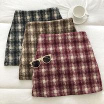skirt Winter 2020 S,M,L Black, red, khaki Short skirt commute High waist lattice Type A 18-24 years old 51% (inclusive) - 70% (inclusive) zipper Korean version