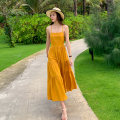 Dress Summer 2020 yellow S,M,L,XL longuette singleton  Sweet One word collar High waist Solid color Socket Big swing camisole 18-24 years old Tuck, open back, lace up 31% (inclusive) - 50% (inclusive) other Bohemia