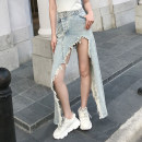 skirt Summer 2020 L,M,S blue Mid length dress street High waist Irregular Solid color Type A 18-24 years old 81% (inclusive) - 90% (inclusive) Denim cotton Asymmetry , Hand worn Europe and America