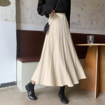 skirt Winter 2020 L (110-120 kg), m (100-110 kg), s (90-100 kg), XS (below 90 kg) Apricot, black longuette commute High waist Pleated skirt Solid color Type A 25-29 years old 31% (inclusive) - 50% (inclusive) knitting polyester fiber fold