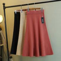 skirt Autumn of 2018 Average size Khaki, black, camel, brick red, light apricot Mid length dress Versatile High waist Umbrella skirt Solid color Type A 81% (inclusive) - 90% (inclusive) knitting