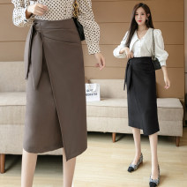 skirt Autumn 2020 S,M,L,XL Grey, black, brown Mid length dress commute High waist Irregular Solid color Type A 25-29 years old YI 31% (inclusive) - 50% (inclusive) other other Pleating, asymmetry, zipper Korean version