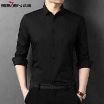 shirt Business gentleman Seven seven 165/84A,170/88A,175/92A,180/96A,185/100A,190/104A Black, blue, green, white, dark grey, coffee routine square neck Long sleeves Self cultivation Travel? autumn youth Business Casual 2020 Solid color Color woven fabric No iron treatment cotton Easy to wear