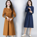 Dress Autumn of 2019 Navy, Caramel M,L,XL,2XL Mid length dress singleton  Long sleeves commute stand collar Elastic waist Solid color Single breasted A-line skirt routine Others 30-34 years old Type A Other / other literature Embroidery, pocket, tridimensional decoration, buttons cotton