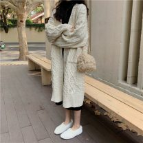 Wool knitwear Winter 2020 Average size Off white coat g, black dress D Long sleeves Cardigan other 51% (inclusive) - 70% (inclusive) Medium length routine commute easy V-neck routine Solid color Single breasted Korean version Button