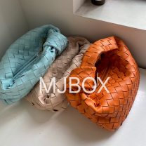 Bag handbag cowhide Woven bag Other / other brand new European and American fashion in leisure time soft zipper yes Solid color Strapless nothing youth Dumpling shape weave Soft handle canvas Inner patch pocket cowhide