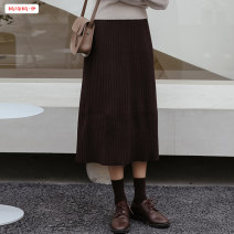skirt Winter 2020 Average size (within 80kg ~ 130kg) Grey black brown Mid length dress commute High waist A-line skirt Solid color Type A 18-24 years old More than 95% knitting Basabai other Resin fixation splicing Korean version Other 100% Pure e-commerce (online only)