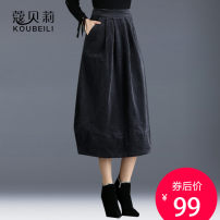 skirt Winter of 2018 19/S 20/M 21/L 22/XL 23/XXL 24/3XL 25/4XL Grey Camel Mid length dress commute Natural waist Fluffy skirt Solid color Type A QZ5099 More than 95% corduroy Corbelle cotton Pleated pockets with decorative stitching Korean version Cotton 97% polyurethane elastic fiber (spandex) 3%
