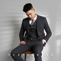 man 's suit dark grey VERTEBRATE/ vertebrate Business gentleman routine 46,48,50,52,54 Polyester 75% viscose 23% polyurethane elastic 2% Self cultivation Double breasted go to work Back middle slit youth Long sleeves Four seasons routine Business Casual Formal dress Flat lapel Round hem lattice
