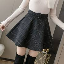 skirt Winter 2020 S,M,L,XL,2XL Black, black grid J, dark gray grid g, light gray grid e Short skirt Versatile High waist Umbrella skirt lattice Type A 25-29 years old QY66 31% (inclusive) - 50% (inclusive) Wool Strap, zipper