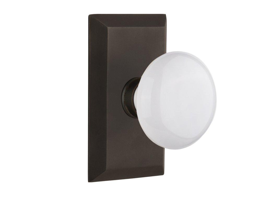 "Nostalgic Warehouse Studio Plate with White Porcelain Knob, Privacy - 2.375"", Oil-Rubbed Bronze"