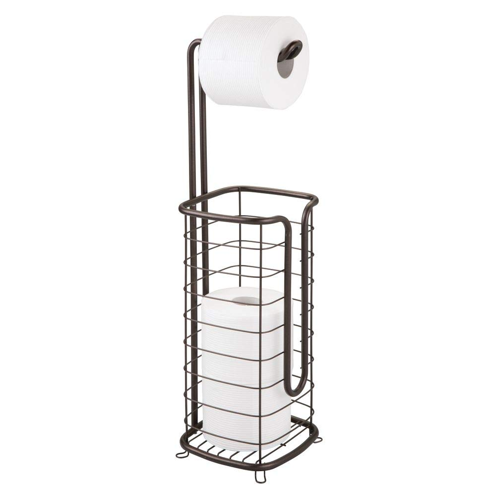 mDesign Metal Free Standing Toilet Paper Holder Stand and Dispenser, with Storage for 3 Spare Rolls of Toilet Tissue While Dispensing 1 Roll for Bathrooms/Powder Rooms - Holds Mega Rolls - Bronze