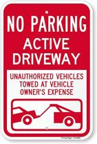 "SmartSign""No Parking - Active Driveway, Unauthorized Vehicles Towed at Owner's Expense"" Sign 