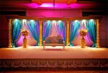 AOFOTO 9x6ft India Culture Ritual Wedding Stage Backdrop Decorations for Reception Tradition Indian Wedding Mandap Canopy Couple Wife Husband Photography Background Video Drape Photo Studio Props